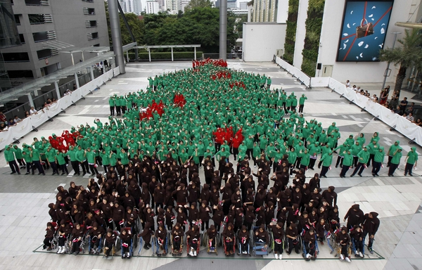 "Eight hundred and fifty-two students gather to break the Guinness World Records with ""The Largest Human Christmas Tree"" outside a shopping mall in Bangkok"